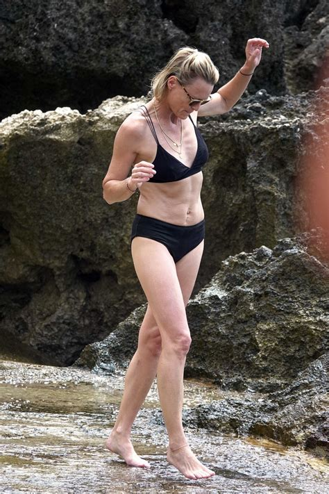 ROBIN WRIGHT in Bikini and Clement Giraudet at a Beach in