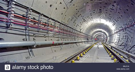 Engineer inspecting newly laid trackwork in a Jubilee Line