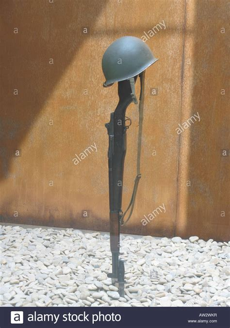 WW2 Garand rifle and M-1 helmet mark resting place for